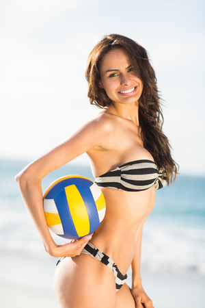 volley ball: Woman holding volley ball on a sunny day