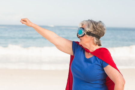 superwoman: Senior woman wearing superwoman custome on a sunny day