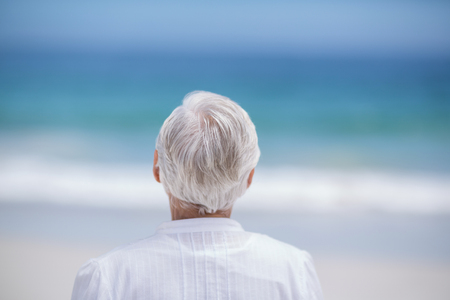 day dreaming: Rear view of mature woman day dreaming at the beach