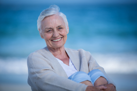 day dreaming: Beautiful mature woman day dreaming on the beach Stock Photo
