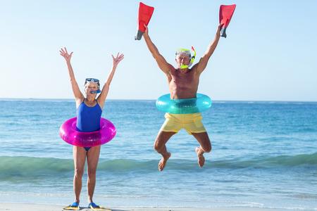 lilo: Senior couple with beach equipment at the beach Stock Photo