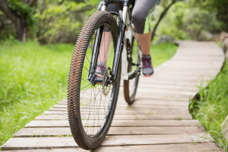 adventuring: Close-up of woman cycling in the countryside Stock Photo