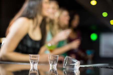 shooter: Three empty shooter glasses in a bar
