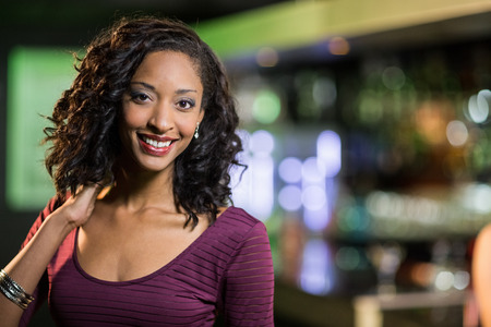 weekend activity: Portrait of smiling woman in a bar Stock Photo