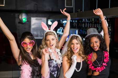 bachelorette party: Friends celebrating bachelorette party in a nightclub