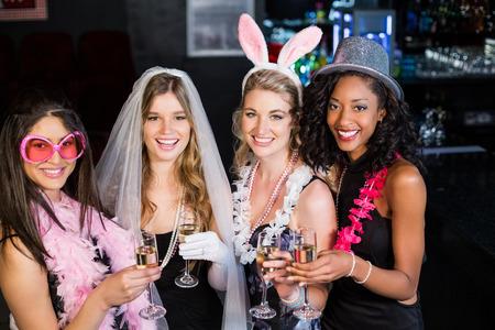 bachelorette party: Amigos celebrando la despedida de soltera en un club nocturno Foto de archivo