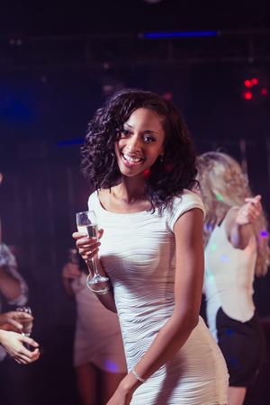 dancing club: Happy woman dancing in a club Stock Photo