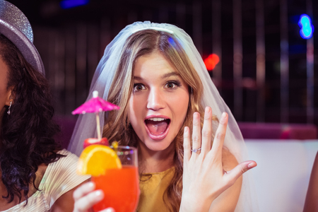 verlobung: Woman showing her engagement ring in a club