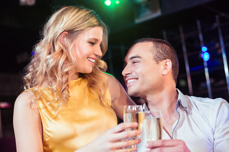 toasting: Couple toasting with champagne in a club