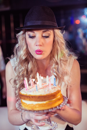 blowing out: Woman blowing out candles for her birthday