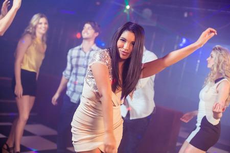 dancing club: Happy friends dancing cheerfully in night club
