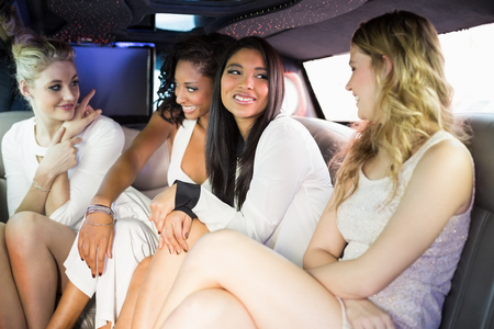 well dressed: Well dressed women in a limousine on a night out