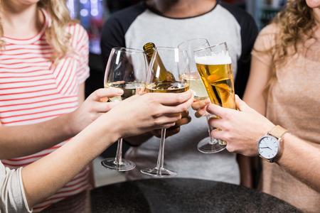 friendliness: Grupo de amigos brindando con cerveza y vino Foto de archivo