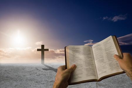 brethren: Man holding a holy bible against cross religion symbol shape over sky Stock Photo