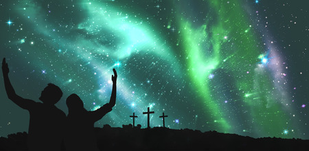 cross arms: Cute couple sitting with arms raised against cross religion symbol shape over sky with aurora borealis