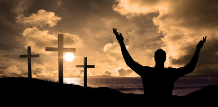 cross arms: happy cheering businessman raising his arms against cross religion symbol shape over sunset sky Stock Photo