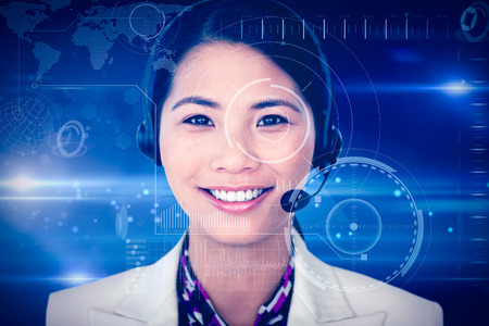 hot secretary: Attractive female engineer smiling at the camera  against black and grey interface