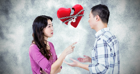 locked: Young couple arguing against locked heart Stock Photo