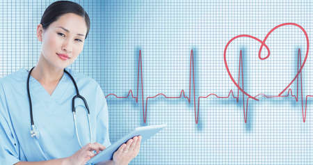 standing together: Surgeon using digital tablet with group around table in hospital against medical background with red ecg line Stock Photo