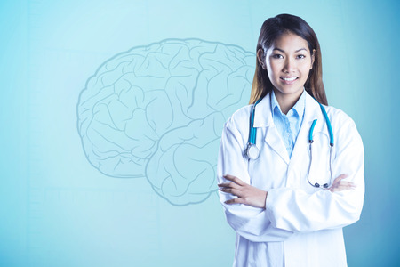 faint: Asian doctor with arms crossed looking at the camera against faint brain on blue background