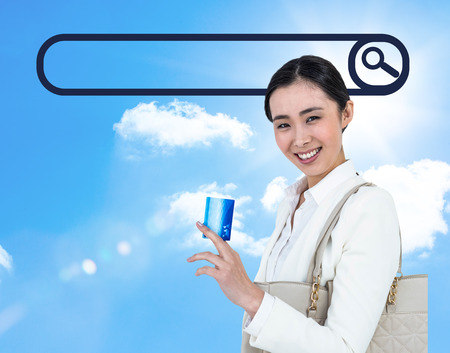 gratified: Caucasian woman holding shopping bags outdoor against a blue sky background
