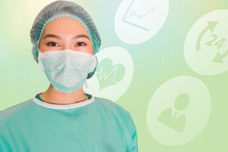 scrub cap: Portrait of surgeon woman against green background