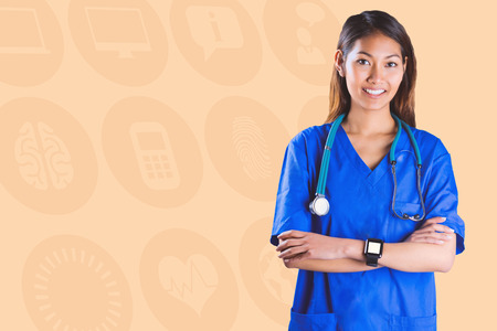 crossing arms: Asian nurse with stethoscope crossing arms against orange background Stock Photo