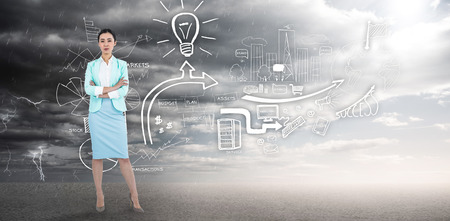 ominous: Elegant businesswoman with crossed arms  against ominous landscape Stock Photo