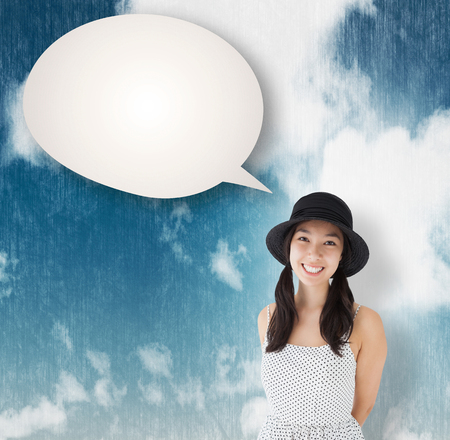 polka dot dress: Cheerful woman with a polka dot dress and hat against blue sky