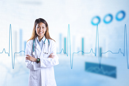 crossing arms: Asian doctor with smart watch crossing arms against blue data