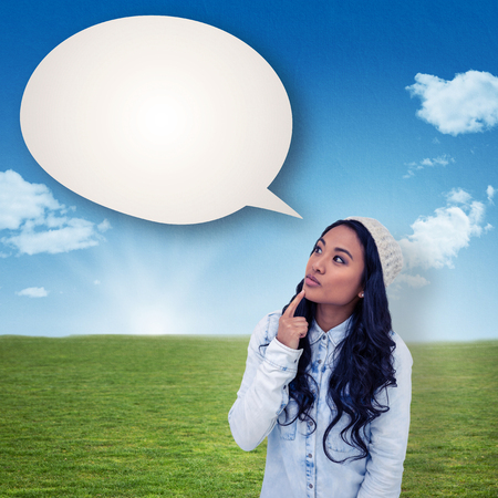 asian style: Asian woman with finger on chin against blue sky over green field