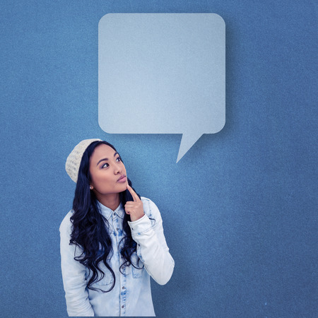 pre adult: Asian woman with finger on chin against blue background with vignette Stock Photo