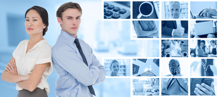 Business colleagues with arms crossed in office against composite image of plant on desk in the office Stock Photo