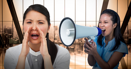 timorous: Angry businesswoman shouting in the office  against room with large window looking on city