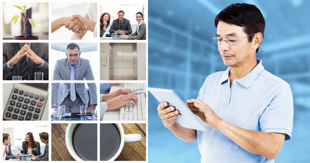 elevator operator: Man using digital tablet while standing against modern room overlooking city Stock Photo