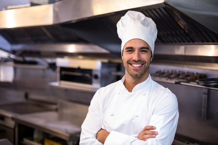 Portrait of handsome chef  in a commercial kitchen