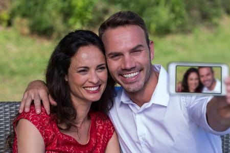 Smiling happy couple taking selfie