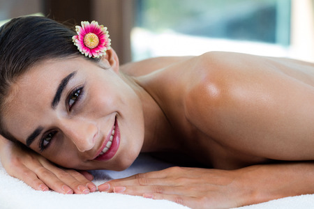 massage  table: Woman relaxing on massage table at spa Stock Photo