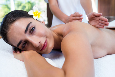 masseuse: Masseuse giving massage to relax woman at spa Stock Photo