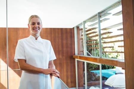 masseuse: Portrait of smiling masseuse at spa