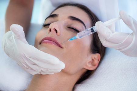 botox: Woman receiving botox injection at spa Stock Photo