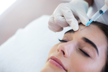 facial spa: Woman receiving botox injection at spa Stock Photo