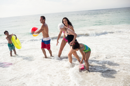 Happy family enjoying on beach on a sunny da Stock Photo