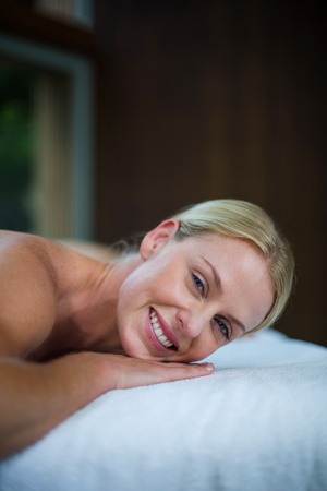 massage  table: Portrait of woman lying on massage table in spa