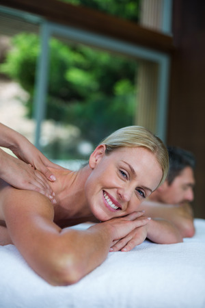 masseur: Portrait of woman receiving back massage from masseur in spa Stock Photo