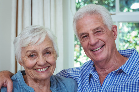 arm around: Close-up portrait of happy senior couple with arm around at home