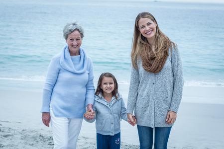 three generations of women: Portrait of three generations of women standing at beach Stock Photo