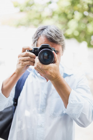 looking into: Man looking into camera in city Stock Photo