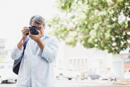 looking into camera: Front view of man looking into camera in city