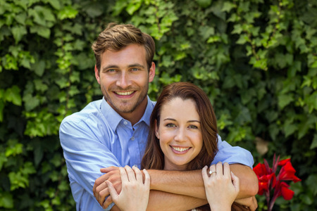 front yard: Portrait of happy couple hugging at front yard Stock Photo